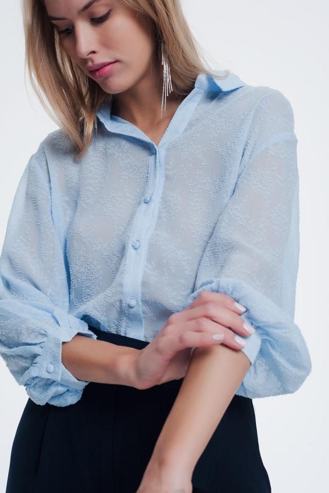 Blusa in filato blu testurizzato