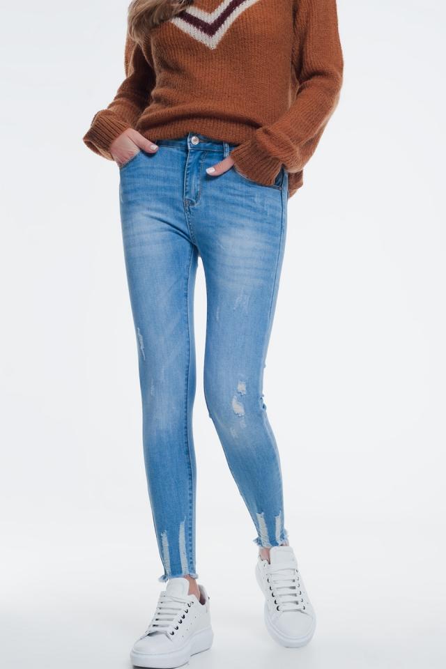 Jeans skinny lavaggio blu con abrasioni