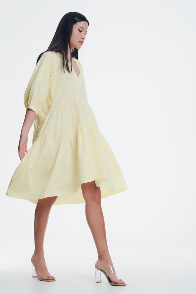 Vestito grembiule al polpaccio con gonna a balze e maniche a palloncino gialla