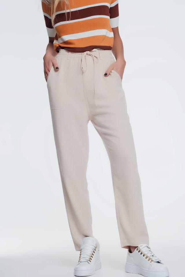Pantaloni beige con elastico in vita