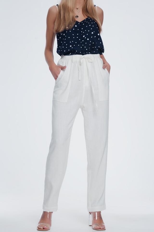Pantaloni crema con elastico in vita