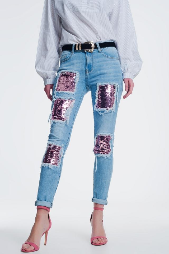 Jeans con strappi al ginocchio e paillettes rosa e oro