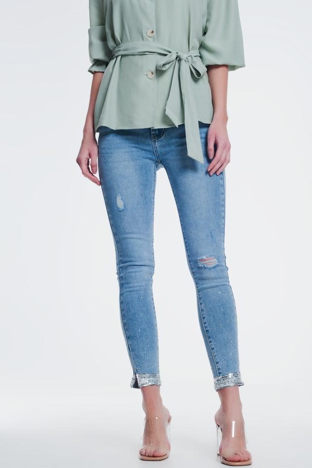 Jeans skinny con strappi alle ginocchia e paillettes
