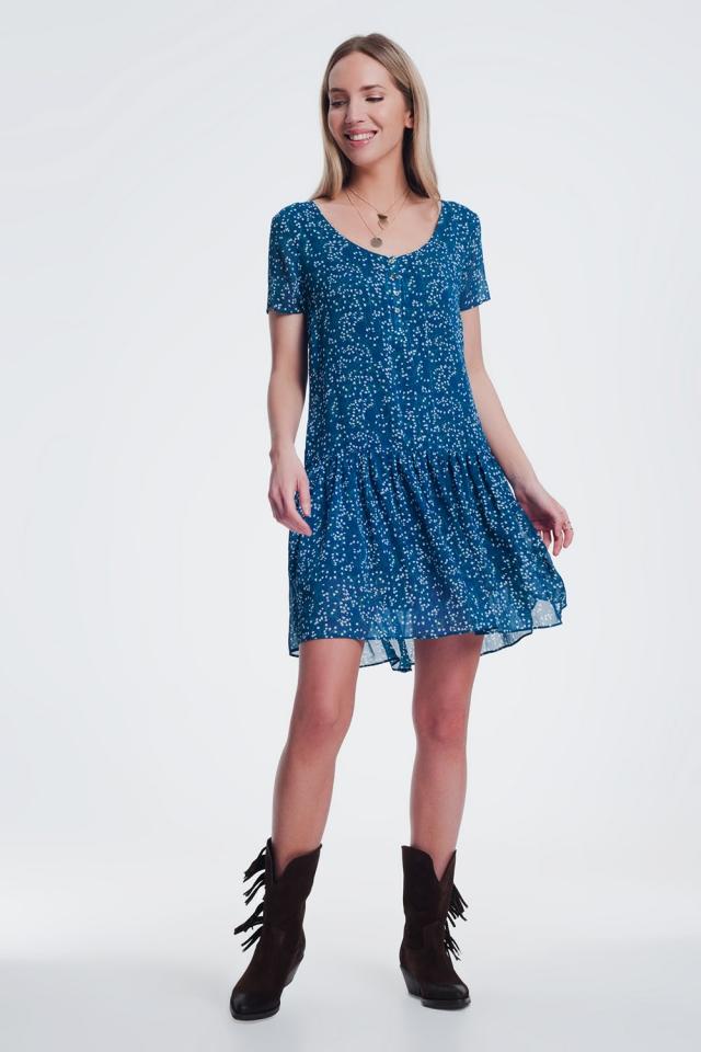 Vestito grembiule peplo corto blu e stampa a fiorellini