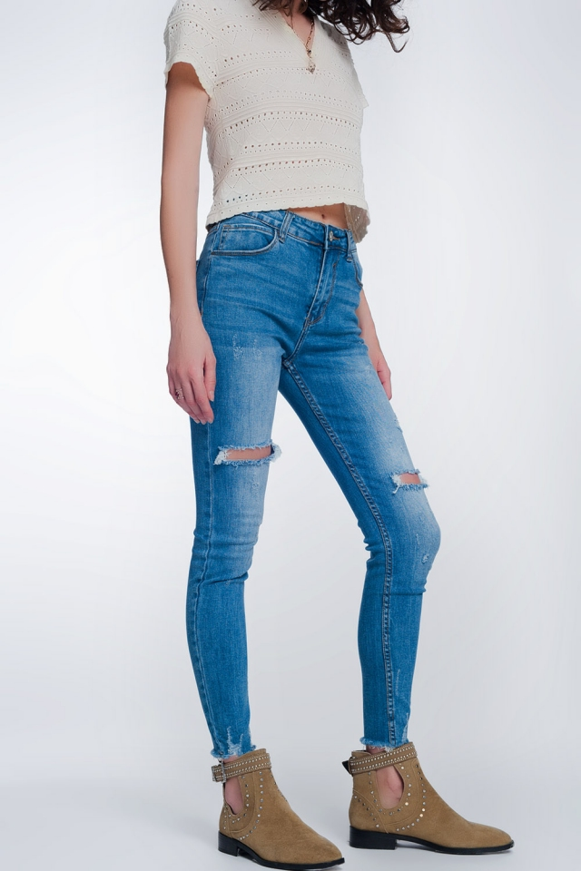 jeans super skinny con fori nelle ginocchia