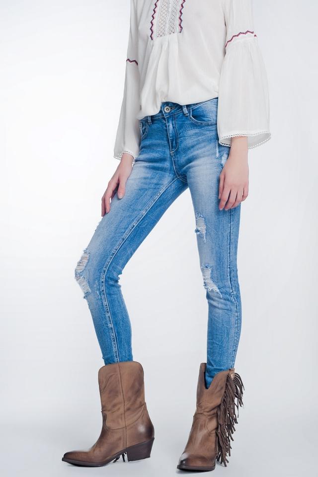 Jeans super skinny blu lavaggio vintage strappati