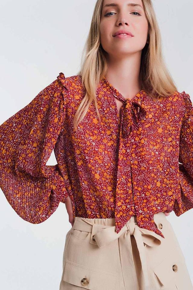 Blusa grembiule in chiffon a fiori con volant