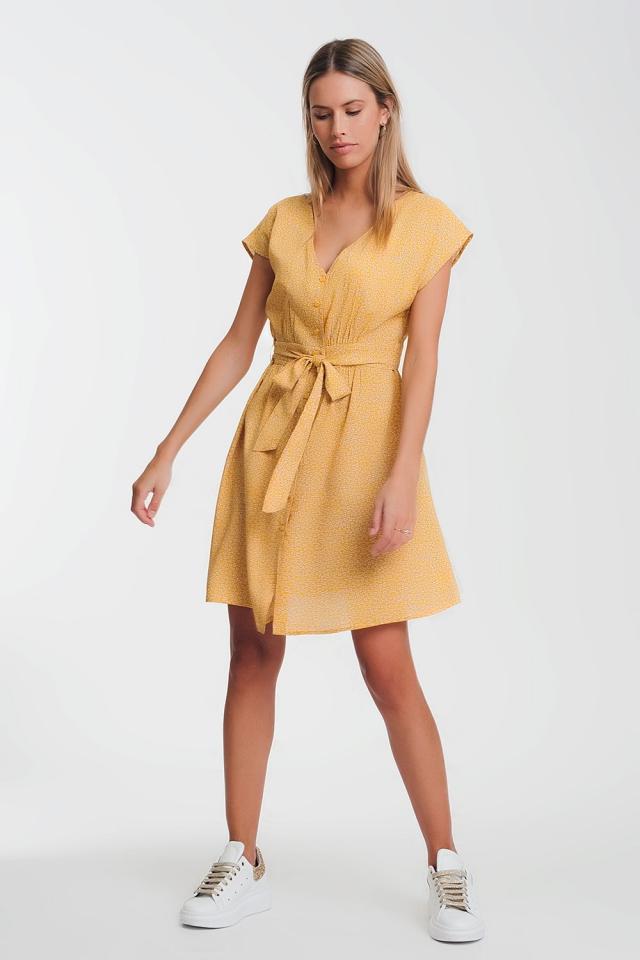Vestito grembiule a fiorellini mustard con bottoni