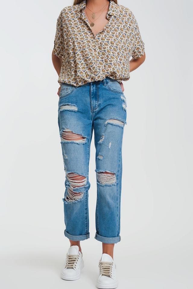 Jeans dritti con strappi