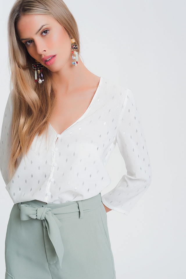 Blusa bianca con scollo a V e stampa metallico