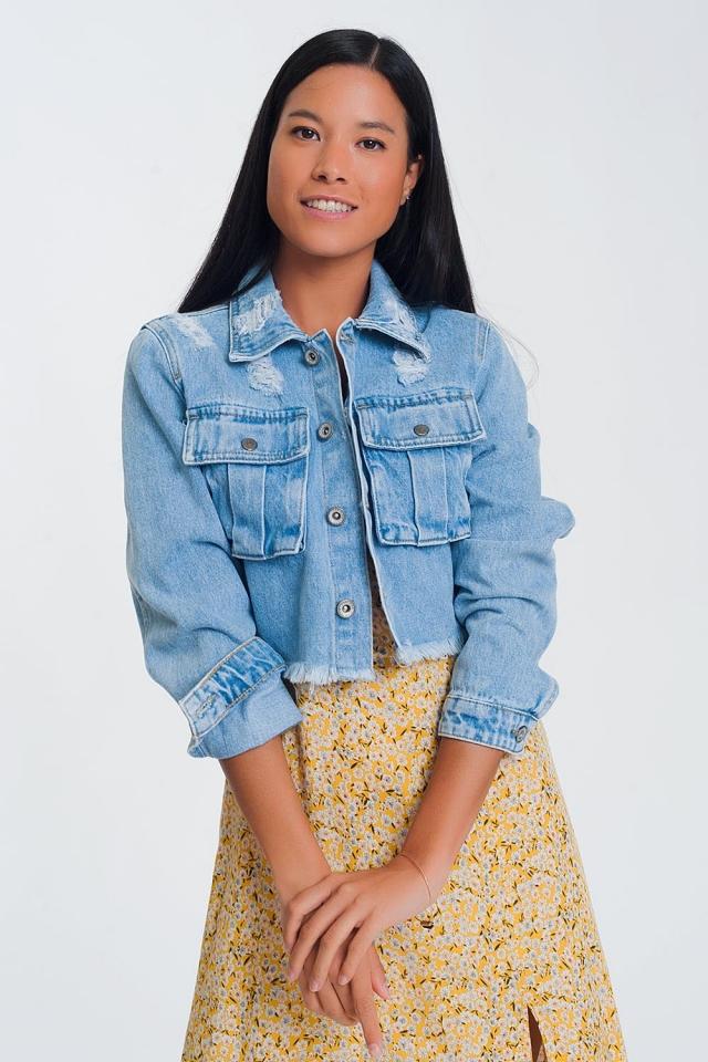 Giacca di jeans corta con fondo grezzo azzurri