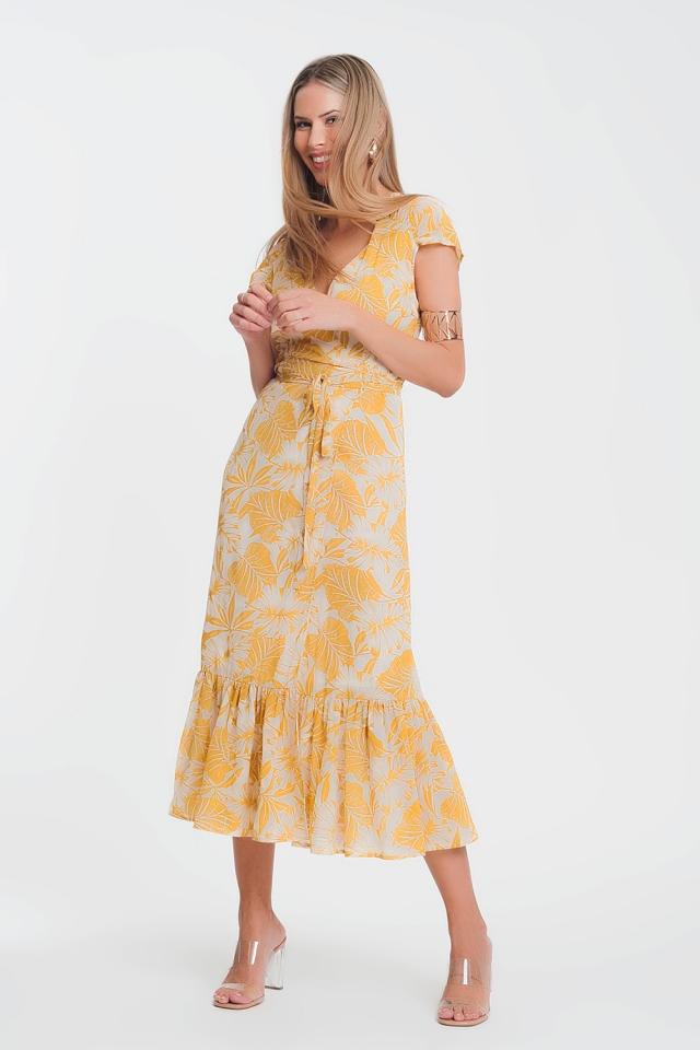 Vestito a portafoglio giallo con scollo profondo e stampa tropicale di palme