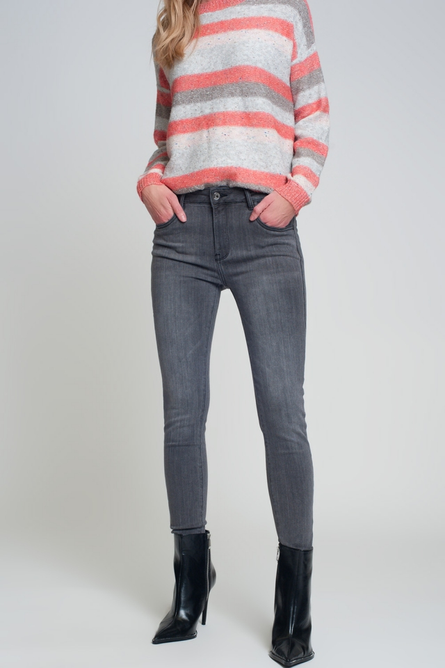 Jeans skinny grigio con spacco laterale