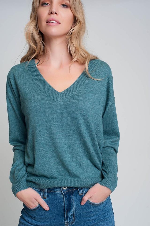 Maglia verde in maglia fine con scollo a V