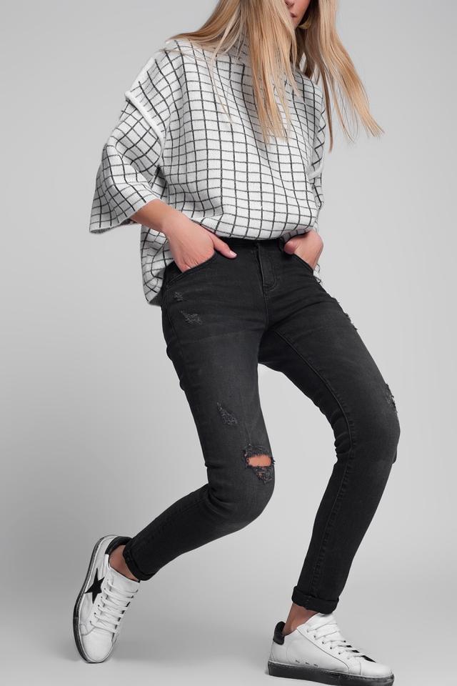 Jeans super skinny strappati lavaggio nero
