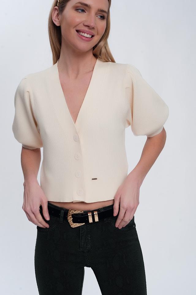 Cardigan color crema con maniche voluminose