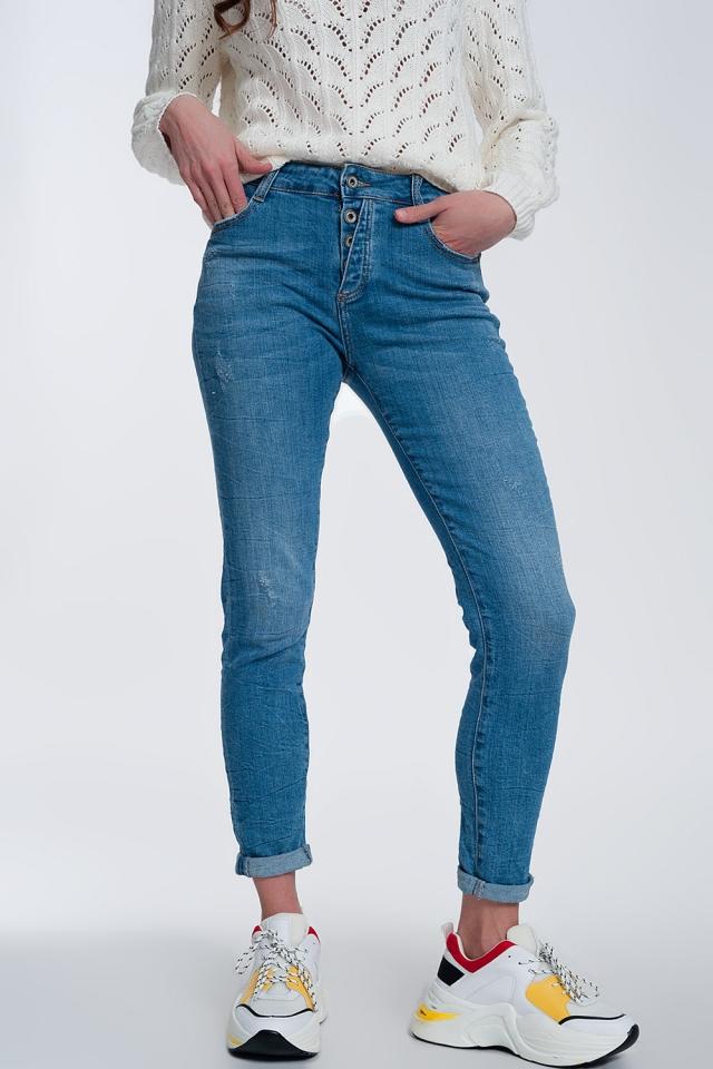Jeans regular con bottoni a vista