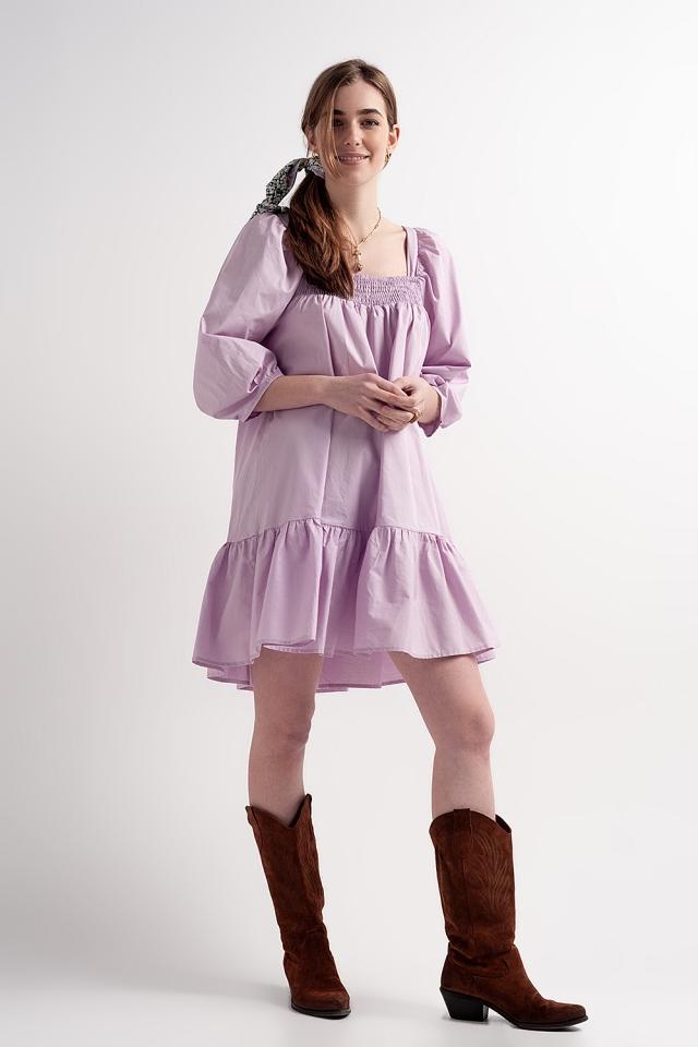 Vestito grembiule corto in popeline di cotone con peplo viola