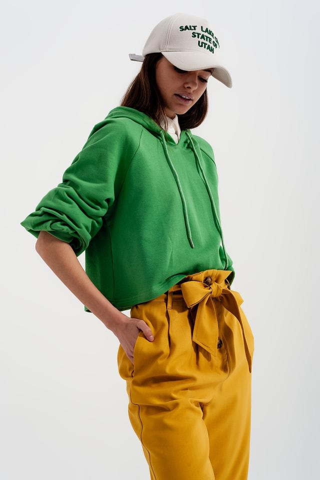 Felpa corta verde con cappuccio e scollo a V