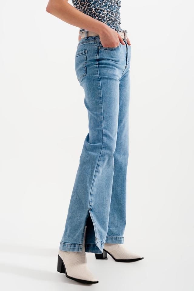 Jeans a zampa e vita alta con spacchi laterali lavati blu
