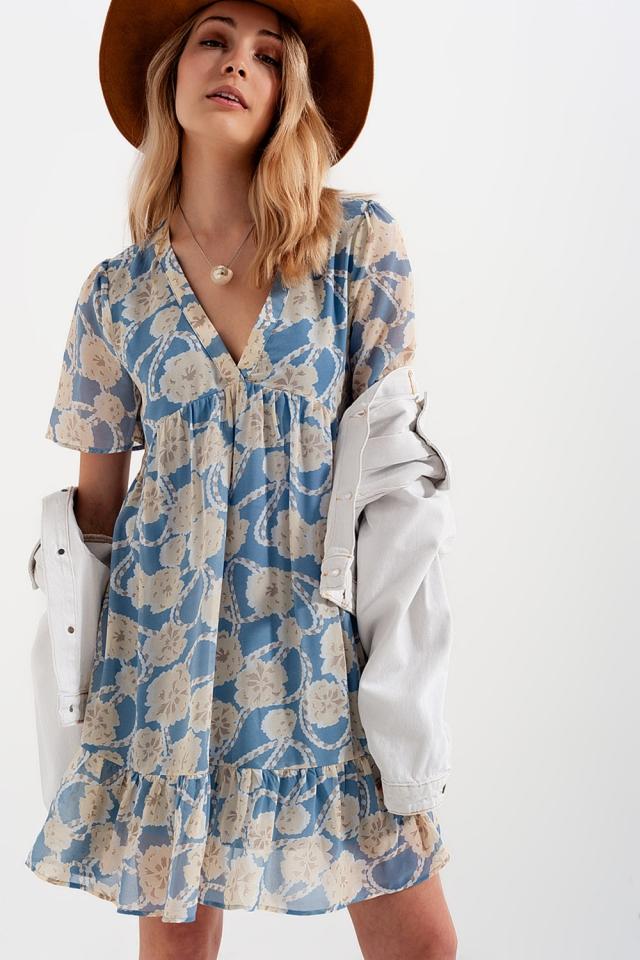 Vestito babydoll corto e stampa a fiori blu