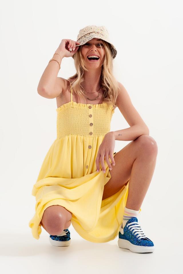 Vestito lungo giallo con corpino arricciato
