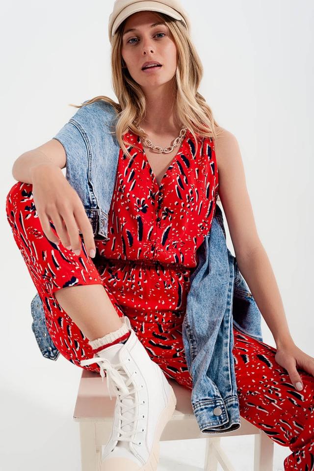 Tuta jumpsuit con stampa mista in rosso