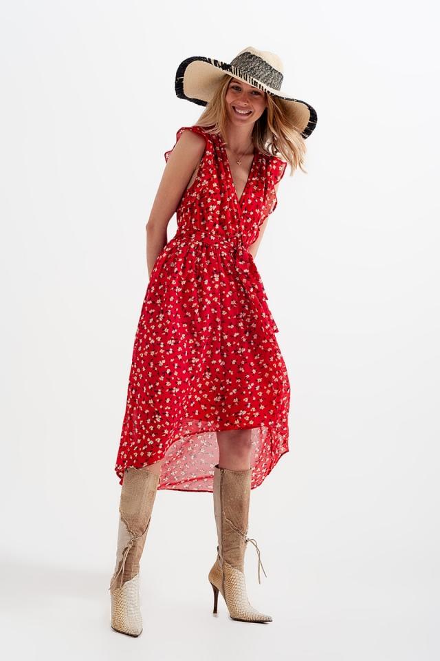 Vestito rosso a fiorellini con fondo asimmetrico e allacciatura sul davanti