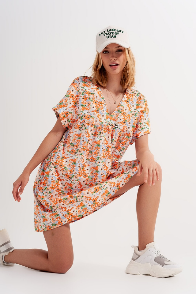 Vestito corto babydoll in cotone arancione a fiori