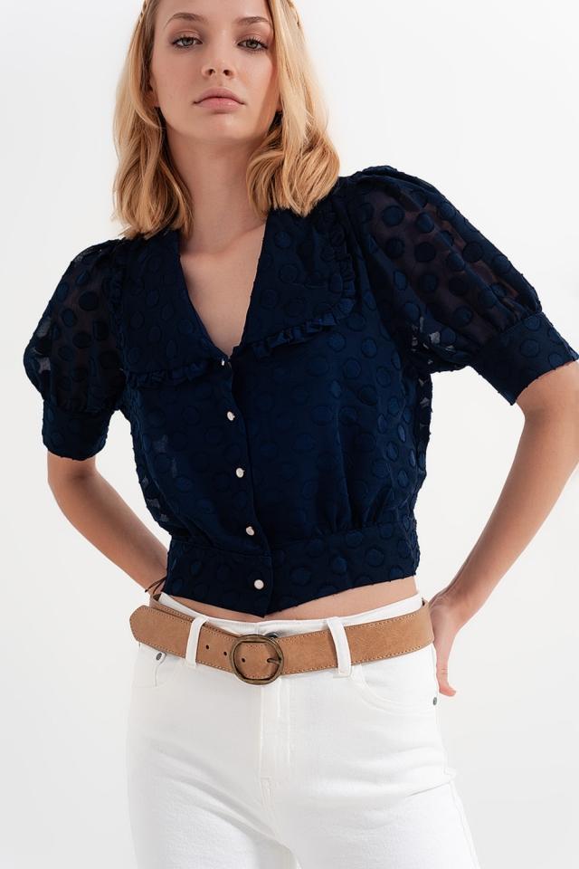 Blusa a pois blu marino con colletto a pettorina e bottoni decorati