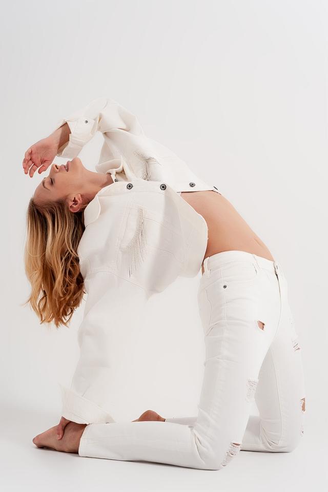 Jeans bianco slavato slim con abrasioni