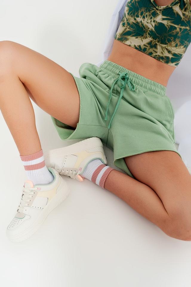 Pantaloncini slim corti in jersey verde