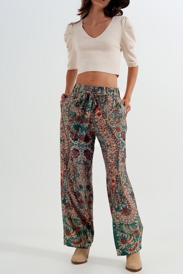 Pantaloni verde a fondo ampio effetto seta con stampa cachemire